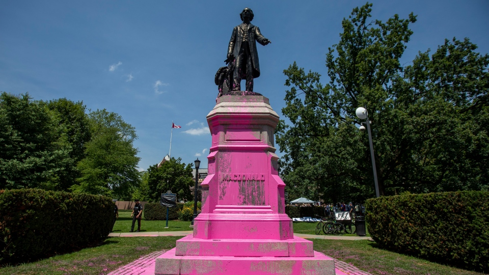 Demonstrators threw pink paint on a statue of Sir. John A. Macdonald at Queen's Park in Toronto on Saturday, July 18, 2020. THE CANADIAN PRESS/Carlos Osorio