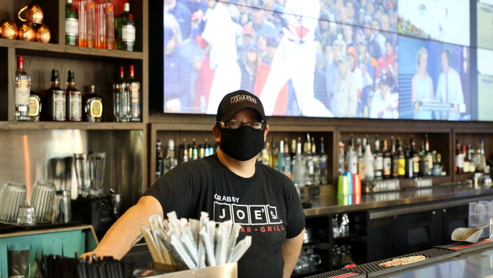 Restaurant manager Shawn McCulligh is seen in downtown Kitchener, Ont., on Friday, July 17, 2020, the first day of Stage 3 reopening in Ontario. McCulligh said it would take time before people start feeling comfortable with eat-in dining. THE CANADIAN PRESS/Colin Perkel