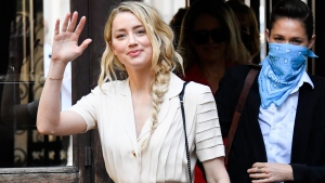 Amber Heard arrives at the High Court, in London, Monday, July 20, 2020. (AP Photo/Alberto Pezzali)