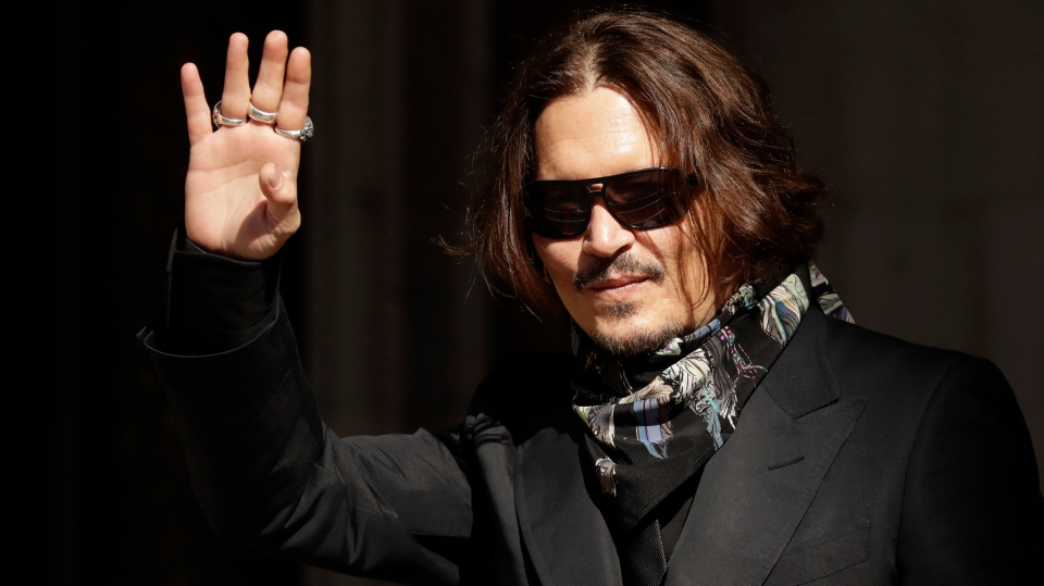 Actor Johnny Depp arrives at the High Court in London, Monday, July 20, 2020. (AP Photo/Matt Dunham)
