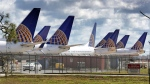 United Airlines planes are parked at Orlando International Airport, in a Tuesday, April 7, 2020 file photo, in Orlando, Fla. (Joe Burbank/Orlando Sentinel via AP, File)