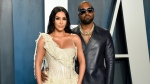 Kim Kardashian West, left, and Kanye West arrive at the Vanity Fair Oscar Party in Beverly Hills, Calif. on Feb. 9, 2020. Kardashian West is asking the public to show compassion and empathy to husband Kanye West, who she says is bipolar and caused a stir this week after fulminating in a series of social media posts. The reality TV star posted a lengthy message Wednesday on her Instagram Live feed, explaining that life has been complicated for her family and West, who ranted against historical figure Harriet Tubman and discussed abortion on Sunday while he declared himself a presidential candidate. (Photo by Evan Agostini/Invision/AP, File)