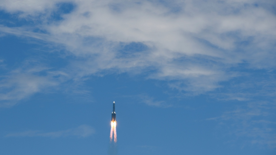 In this photo released by China's Xinhua News Agency, a Long March-5 rocket carrying the Tianwen-1 Mars probe lifts off from the Wenchang Space Launch Center in southern China's Hainan Province, Thursday, July 23, 2020. China launched its most ambitious Mars mission yet on Thursday in a bold attempt to join the United States in successfully landing a spacecraft on the red planet. (Yang Guanyu/Xinhua via AP)