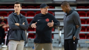 Toronto Raptors head coach Nick Nurse, centre, gestures while talking to team president Masai Ujiri as general manager Bobby Webster (left) looks on during training camp practice, Tuesday, October 1, 2019 at Laval University in Quebec City. THE CANADIAN PRESS/Jacques Boissinot