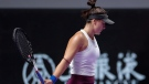Bianca Andreescu of Canada reacts as she plays against Karolina Pliskova of the Czech Republic during the WTA Finals Tennis Tournament in Shenzhen, China's Guangdong province, Wednesday, Oct. 30, 2019. (AP Photo/Andy Wong)