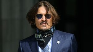 Actor Johnny Depp arrives at the High Court for a hearing in his libel case, in London, Friday, July 24, 2020. (Aaron Chown/PA via AP)