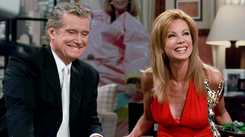 "FILE - In this July 28, 2000 file photo, Kathie Lee Gifford and co-host Regis Philbin reminisce during her last appearance on the show, in New York. Philbin, the genial host who shared his life with television viewers over morning coffee for decades and helped himself and some fans strike it rich with the game show ""Who Wants to Be a Millionaire,"" has died on Friday, July 24, 2020. (AP Photo/Richard Drew)"