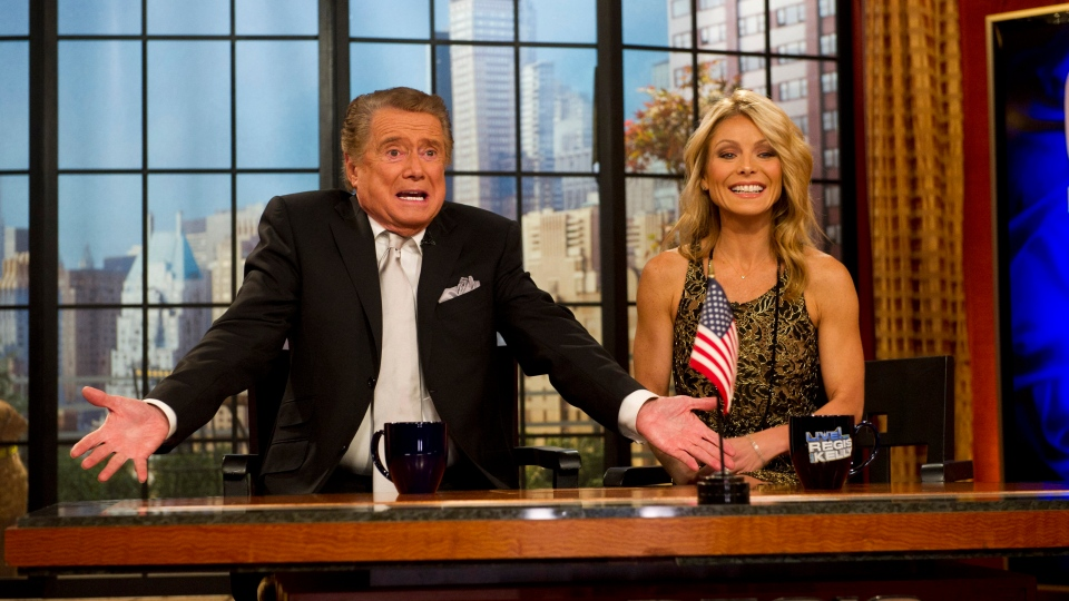"FILE - In this Nov. 18, 2011 file photo, Regis Philbin and Kelly Ripa appear on Regis' farewell episode of ""Live! with Regis and Kelly"", in New York. Philbin, the genial host who shared his life with television viewers over morning coffee for decades and helped himself and some fans strike it rich with the game show ""Who Wants to Be a Millionaire,"" has died on Friday, July 24, 2020. (AP Photo/Charles Sykes, File)"