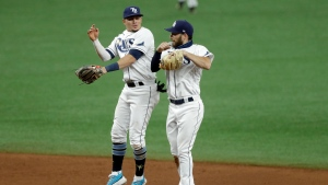 Tampa Bay Rays' Brandon Lowe, right, and Willy Adames celebrate after the team closed out the Toronto Blue Jays during the ninth inning of a baseball game Saturday, July 25, 2020, in St. Petersburg, Fla. (AP Photo/Chris O'Meara)