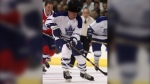 Toronto Maple Leafs' forward Eddie (The Entertainer) Shack, decked out in a cowboy hat, heads up ice with the puck during the Heroes of Hockey oldtimers game at the NHL All-Star weekend in Toronto, Saturday, Feb. 5, 2000. (CP PHOTO/Kevin Frayer)