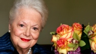 """FILE - In this file photo dated Wednesday, Sept. 15, 2004, Actress Olivia de Havilland, who played the doomed Southern belle Melanie in """"Gone With the Wind,"""" poses for a photograph, in Los Angeles, USA. Olivia de Havilland, Oscar-winning actress has died, aged 104 in Paris, publicist says Sunday July 26, 2020. (AP Photo/Kevork Djansezian, FILE)"""