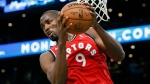 Toronto Raptors' Serge Ibaka grabs a rebound during the first half on an NBA basketball game against the Boston Celtics in Boston, Saturday, Dec. 28, 2019. (AP Photo/Michael Dwyer)