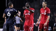 Toronto FC forward Jozy Altidore, center, congratulates New York City FC defender Alexander Callens (6) in front of Toronto FC defender Omar Gonzalez (44) after an MLS soccer match, Sunday, July 26, 2020, in Kissimmee, Fla. New York City FC won 3-1. (AP Photo/John Raoux)