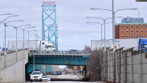 Transport trucks and other vehicles are seen near the Ambassador Bridge at the Canada/USA border crossing in Windsor, Ont. on Saturday, March 21, 2020. THE CANADIAN PRESS/Rob Gurdebeke