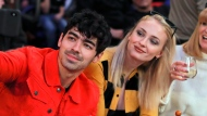 Musician Joe Jonas, left, takes a selfie with actress Sophie Turner during a break in play of an NBA basketball game between the New York Knicks and the Sacramento Kings, Saturday, March 9, 2019, in New York. (AP Photo/Julie Jacobson)