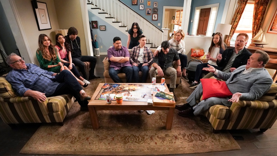 "This image released by ABC shows the cast of ""Modern Family,"" from left, Ed O'Neill, Sofia Vergara, Sarah Hyland, Reid Ewing, Rico Rodriguez, Ariel Winter, Nolan Gould, Ty Burrell, Julie Bowen, Aubrey Anderson-Emmons, Jesse Tyler Ferguson and Eric Stonestreet. The list of contenders for the 72nd prime-time Emmy Awards will be announced Tuesday in a virtual ceremony. (Eric McCandless/ABC via AP)"
