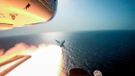 In this photo released Tuesday, July 28, 2020, by Sepahnews, Revolutionary Guard's helicopter fires a missile during an exercise. (Sepahnews via AP)