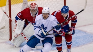 Toronto Maple Leafs centre Auston Matthews (34) battles with Montreal Canadiens defenceman Cale Fleury (20) in front of goaltender Carey Price during second period NHL exhibition hockey action ahead of the Stanley Cup playoffs in Toronto on Tuesday, July 28, 2020. THE CANADIAN PRESS/Frank Gunn