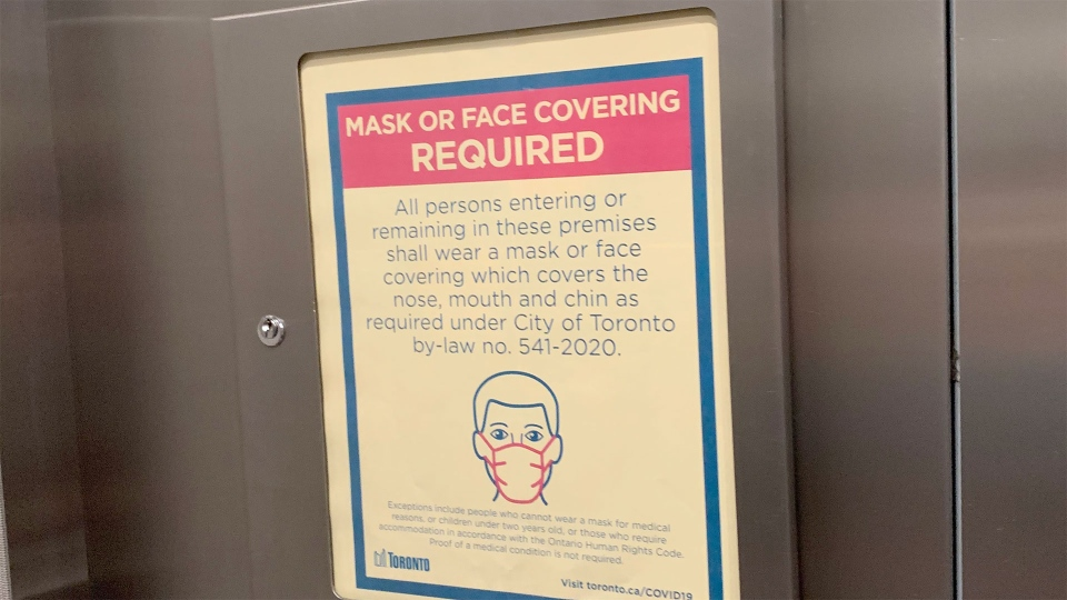 A sign reminding residents that they must wear a mask is pictured in a condominium elevator in downtown Toronto Tuesday July 28, 2020. (Joshua Freeman /CP24)