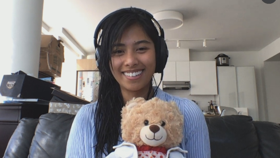 Mara Soriano holds the teddy bear containing her late mother's voice recording. The bear was returned to Soriano on Tuesday after it was stolen last week.