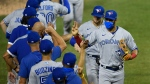 Toronto Blue Jays left fielder Lourdes Gurriel Jr., right front, and teammates celebrate after a baseball game against the Washington Nationals, Tuesday, July 28, 2020, in Washington. The Blue Jays won 5-1. (AP Photo/Nick Wass)