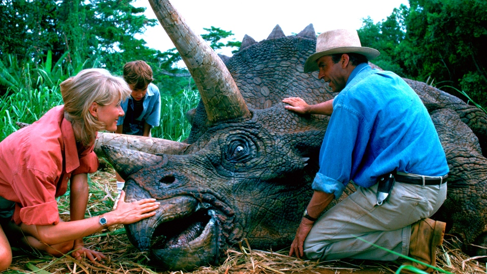 "This image released by Universal Pictures shows, from left, Laura Dern, Joseph Mazzello and Sam Neill in a scene from the 1993 film ""Jurassic Park."" (Universal Pictures via AP)"