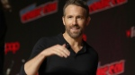 """Ryan Reynolds is seen at New York Comic Con, in New York City, Oct. 3, 2019. The Vancouver-born """"Deadpool"""" actor announced plans on Friday for the Group Effort Initiative, which will recruit 10 to 20 trainees from Black, Indigenous and """"all other marginalized communities"""" to work alongside experienced professionals on his next movie. THE CANADIAN PRESS/AP-Steve Luciano"""