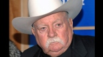 "In this Monday, Dec. 14, 2009 file photo, Actor Wilford Brimley attends the premiere of 'Did You Hear About The Morgans' at the Ziegfeld Theater in New York. Wilford Brimley, who worked his way up from stunt performer to star of film such as ""Cocoon"" and ""The Natural,"" has died. He was 85. Brimley's manager Lynda Bensky said the actor died Saturday morning, Aug. 1, 2020 in a Utah hospital. (AP Photo/Evan Agostini, File)"