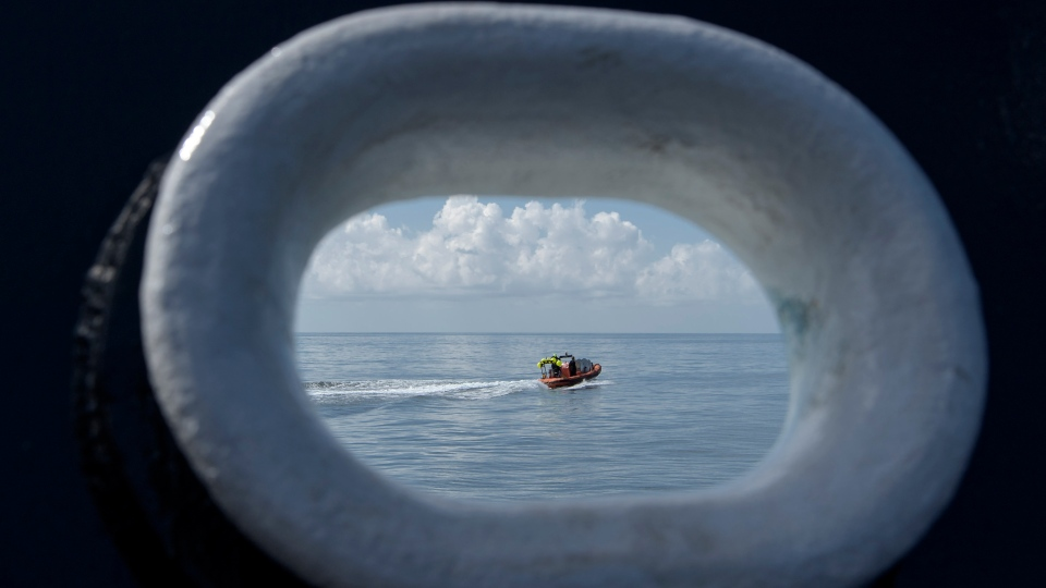 SpaceX support teams are deployed on fast boats from the SpaceX GO Navigator recovery ship ahead of the landing of the SpaceX Crew Dragon Endeavour spacecraft with NASA astronauts Robert Behnken and Douglas Hurley onboard, Sunday, Aug. 2, 2020, in the Gulf of Mexico off the coast of Pensacola, Fla. The Demo-2 test flight for NASA's Commercial Crew Program is the first to deliver astronauts to the International Space Station and return them to Earth onboard a commercially built and operated spacecraft. Behnken and Hurley are returning after spending 64 days in space. (Bill Ingalls/NASA via AP)