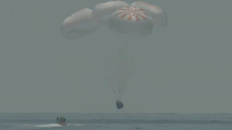 In this frame grab from NASA TV, the SpaceX capsule splashes down Sunday, Aug. 2, 2020 in the Gulf of Mexico. Astronauts Doug Hurley and Bob Behnken spent a little over two months on the International Space Station. It will mark the first splashdown in 45 years for NASA astronauts and the first time a private company has ferried people from orbit. (NASA TV via AP) (NASA TV via AP)