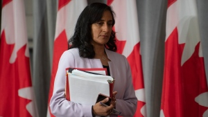 Public Services and Procurement Minister Anita Anand walks across the stage at the start of a news conference, Tuesday, July 21, 2020 in Ottawa. THE CANADIAN PRESS/Adrian Wyld