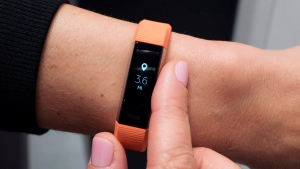 In this March 1, 2017, file photo, Fitbit's new Alta HR device is displayed in New York. (AP Photo/Mark Lennihan, File)