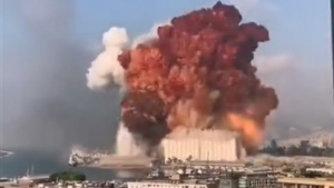 A large explosion is seen in a port area of Beirut, Lebanon on Aug. 4, 2020. (Twitter/@GinoRaidy)