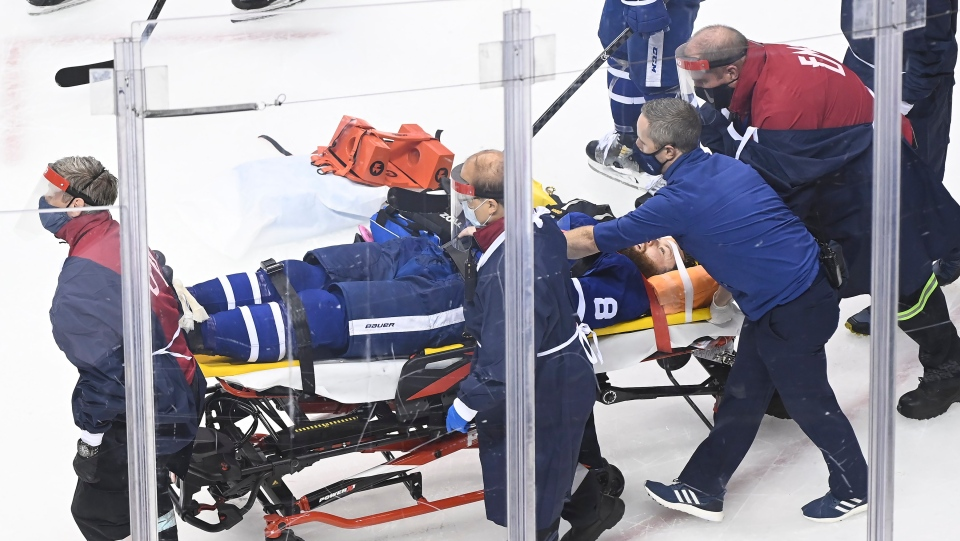 Toronto Maple Leafs defenceman Jake Muzzin (8) leaves the ice on a stretcher while playing against the Columbus Blue Jackets during third period NHL Eastern Conference Stanley Cup playoff action in Toronto on Tuesday, August 4, 2020. THE CANADIAN PRESS/Nathan Denette