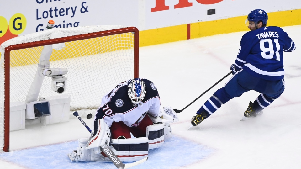 Toronto Maple Leafs centre John Tavares (91) scores past Columbus Blue Jackets goaltender Joonas Korpisalo (70) during third period NHL Eastern Conference Stanley Cup playoff action in Toronto on Tuesday, August 4, 2020. THE CANADIAN PRESS/Nathan Denette