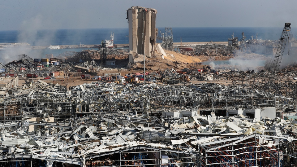 Rescue workers and security officers work at the scene of an explosion that hit the seaport of Beirut, Lebanon, Wednesday, Aug. 5, 2020. (AP Photo/Hussein Malla)