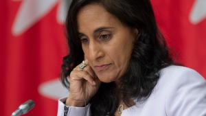 Public Services and Procurement Minister Anita Anand listens to a translation aid during a news conference, Tuesday, July 21, 2020 in Ottawa. Canada is signing deals with Pharmaceutical giant Pfizer and U.S.-based biotech firm Moderna to procure millions of doses of their experimental COVID-19 vaccines. THE CANADIAN PRESS/Adrian Wyld