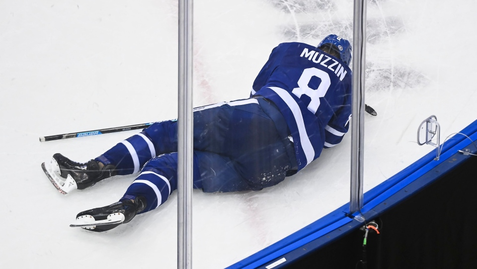 Toronto Maple Leafs defenceman Jake Muzzin (8) lays injured on the ice as they play against the Columbus Blue Jackets during third period NHL Eastern Conference Stanley Cup playoff action in Toronto on Tuesday, August 4, 2020. Muzzin would leave the ice on a stretcher. THE CANADIAN PRESS/Nathan Denette
