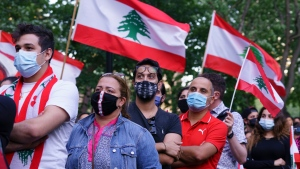Members of the Lebanese community attend a vigil to honour those who died and were injured in the massive blast in Beirut in Montreal on Wednesday, August 5, 2020. THE CANADIAN PRESS/Paul Chiasson