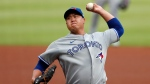 Toronto Blue Jays starting pitcher Hyun-Jin Ryu (99), of South Korea, works in the first inning of a baseball game against the Atlanta Braves Wednesday, Aug. 5, 2020, in Atlanta. (AP Photo/John Bazemore)