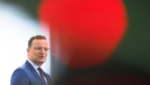 German Health Minister Jens Spahn briefs the media about the developing of the coronavirus crisis test strategy in Berlin, Germany, Thursday, Aug. 6, 2020. (AP Photo/Markus Schreiber)