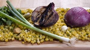 Cedar-grilled corn and red onion salsa is seen in this April 6, 2010 photo. Health authorities are warning consumers in Central and Western to avoid eating red onions imported from the U.S. that have been linked to a Salmonella outbreak. THE CANADIAN PRESS/AP/Larry Crowe