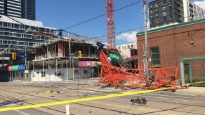 The intersection of River and Dundas streets is currently closed after a stationary crane fell in a Regent Park construction site.