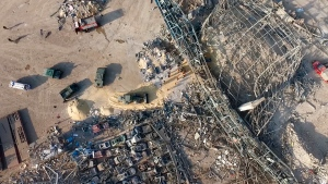 This photo taken from footage from a drone and provided by the Russian Emergency Situations Ministry press service shows the site of the explosion in the port of Beirut, Lebanon, on Thursday, Aug. 6, 2020. Rescue teams were still searching the rubble of Beirut's port for bodies on Friday, Aug. 7, 2020, nearly three days after a massive explosion sent a wave of destruction through Lebanon's capital, killing nearly 150 people and wounding thousands. (Russian Ministry of Emergency Situations press service via AP)
