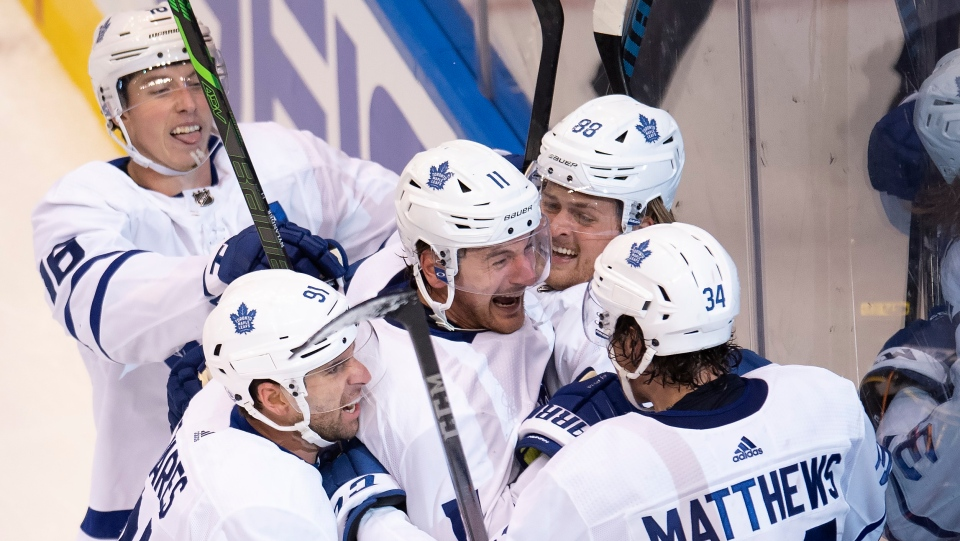 Toronto Maple Leafs left wing Zach Hyman (11) is congratulated by teammates William Nylander (88), Auston Matthews (34), John Tavares (91) and Mitchell Marner (16) after scoring the game tying goal with seconds left in third period NHL Eastern Conference Stanley Cup playoff action against the Columbus Blue Jackets in Toronto on Friday, August 7, 2020. THE CANADIAN PRESS/Frank Gunn