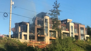 Crews are on the scene of a townhouse fire in Richmond Hill. (Brandon Gonez/ CP24)