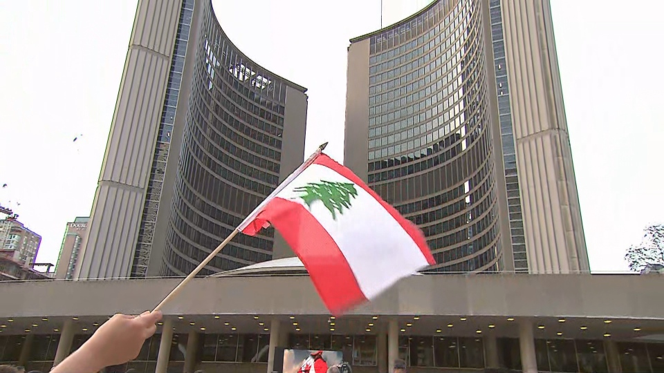 A candlelight vigil is held at Nathan Phillips Square for the victims of the Beirut blast.