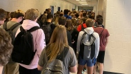In this photo posted on Twitter, students crowd a hallway, Tuesday, Aug. 4, 2020, at North Paulding High School in Dallas, Ga.  The Georgia high school student says she has been suspended for five days because of photos of crowded conditions that she provided to The Associated Press and other news organizations. Hannah Watters, a 15-year-old sophomore at North Paulding High School, says she and her family view the suspension as overly harsh and are appealing it. (Twitter via AP, File)