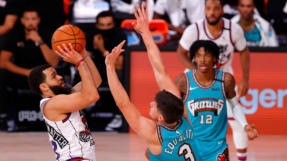 Fred VanVleet, left, of the Toronto Raptors scores a basket and draws the foul as Grayson Allen, right, of the Memphis Grizzlies' defends during the first half of an NBA basketball game Sunday, Aug. 9, 2020, in Lake Buena Vista, Fla. (Kevin C. Cox/Pool Photo via AP)