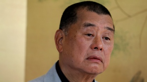In this July 1, 2020, file photo, Hong Kong media tycoon Jimmy Lai pauses during an interview in Hong Kong. (AP Photo/Vincent Yu, File)